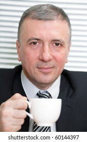 Businessman with a white cup