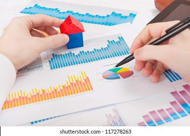 Businessman in white shirt analyzing charts and graphs