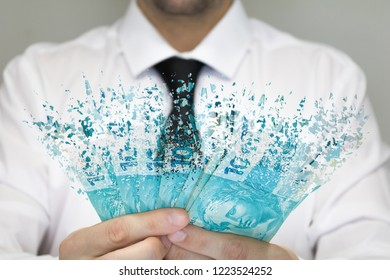 Businessman in white shirt and black tie holding Real hundred note. Brazilian money being disintegrated. Selective focus. 100  disintegrating.