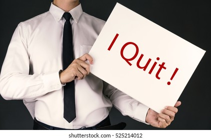 """Businessman in white shirt holding """"I Quit """" word with vintage color photo style"""