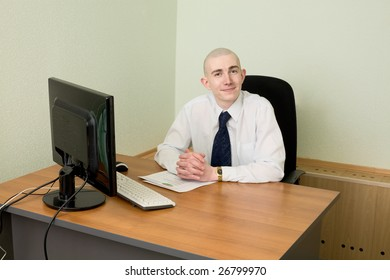 The businessman in a white shirt on a workplace