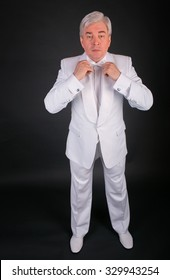 businessman in a white suit