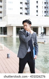 Businessman who has a shoulder pain.