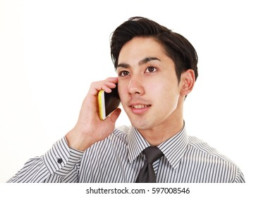Businessman who is talking on a smart phone