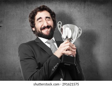 businessman with a winner cup
