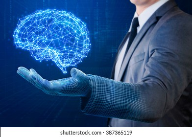 businessman with wire frame hand holding glow abstract brain structure