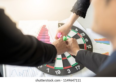 Businessman and woman are brainstorming on to creative new business idea as teamwork concept.