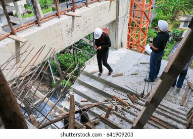 businessman and woman engineering in construction building working site