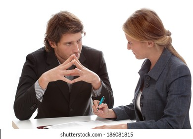 A businessman and woman exchanging mysterious glances at work