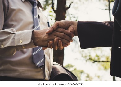Businessman and woman shake hands after business meeting closeup. a business start up welcome, introduction, greet or thanks gesture, partnership approval, dealing, greeting and partner concept.