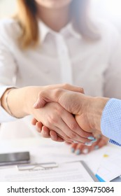 Businessman and woman shake hands as hello in office closeup. Friend welcome introduction greet or thanks gesture product advertisement partnership approval arm strike a bargain on deal concept