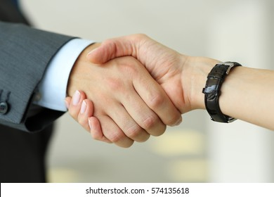 Businessman and woman shake hands as hello in office closeup. Friend welcome, introduction, greet or thanks gesture, product advertisement, partnership approval, arm, strike a bargain on deal concept