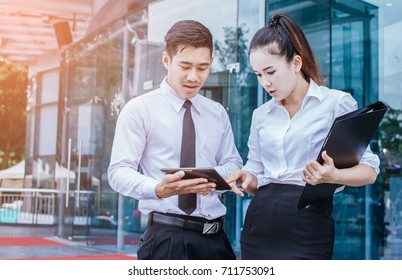 businessman and woman using tablet of working. Meetings the commercial processes involved in promoting. Together create a mutually beneficial .outside