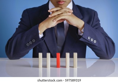 Businessman with wooden blocks - Business concept of choosing the right ideal choice