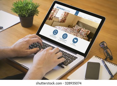 Businessman at work booking a room. Close-up top view of man booking a room on laptop. all screen graphics are made up.