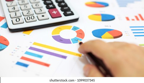 Businessman at work. Business charts and graphs, calculator, pencil