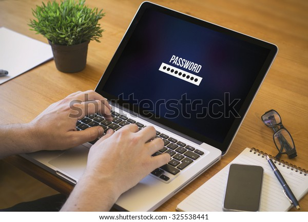 Businessman at work. Close-up top view of man working on laptop password. All screen graphics are made up.