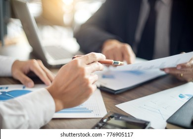 Businessman work with computer on table in office work with paper graph chart business marketing plan analysis