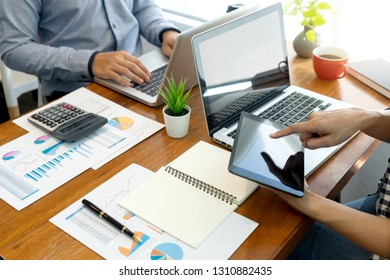 businessman work with friend on the table with computer laptop calulator ,working data analyses for business plan and marketing.