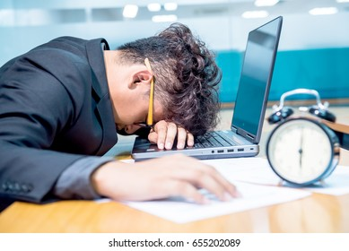 businessman work hard and sleep on laptop, It's time to leave work but still busy. Mental health, PTSD and suicide prevention. Post-traumatic stress disorder.