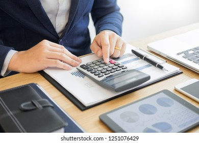 Businessman work on Desk office business financial analysis charts or graphs accounting  calculating bugget money tax loan inspector making report.