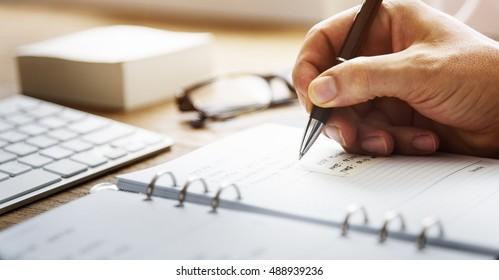 Businessman Working Agenda Writing Plan Concept
