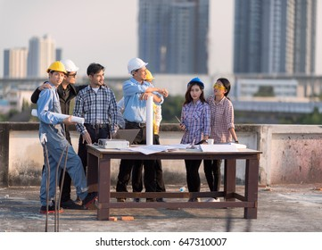 Portrait happy professional construction engineer woman foto de businessman working with architect engineer on the rooftop building construction site with blueprint malvernweather Images