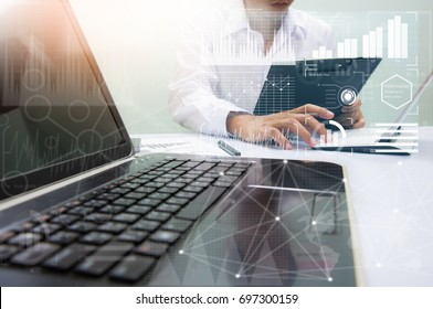 businessman working with business documents on office table with digital tablet computer and graph finance diagram in the background
