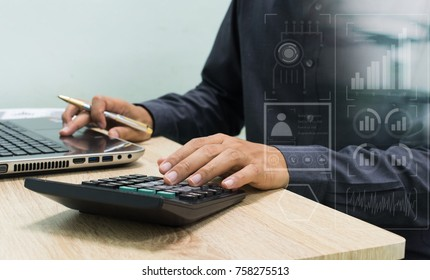 businessman working with business documents on wooden office table with computer notebook and calculator