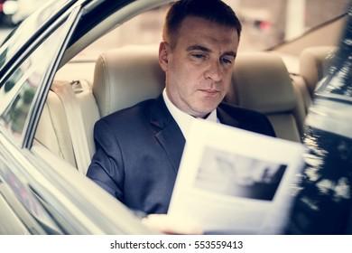 Businessman Working Busy Car Inside