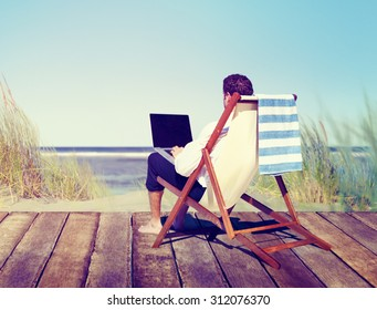 Businessman Working by the Beach Relaxation Concept