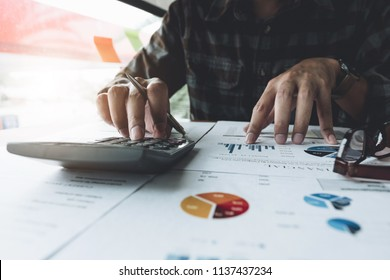 businessman working with calculator, business document. accountant doing accounting and calculating. bookkeeper making calculation. Savings, finance