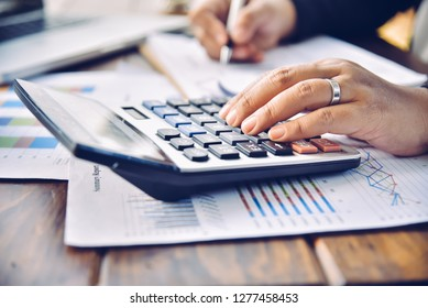 Businessman are working with a calculator and document. Meeting report in progress. in office business concept