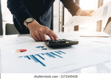 Businessman working with calculator and laptop computer for financial, tax, revenue