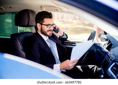 Businessman working from car