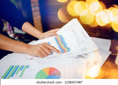 Businessman working at a computer office And graphs on his desk. Business ideas and space for copy.