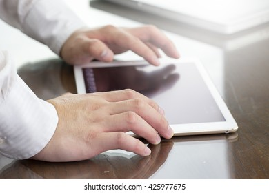 businessman working with digital tablet computer on his desk.