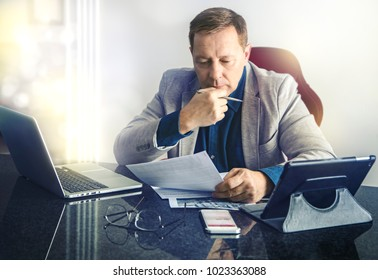 Businessman working with documents at the office table , horizontal