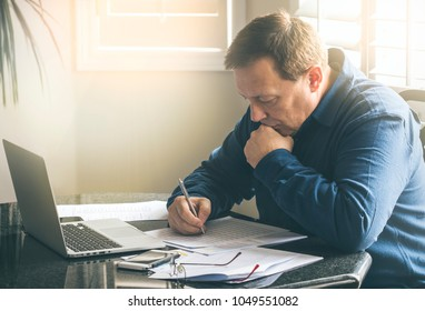 Businessman working with documents at the office table , horizontal image