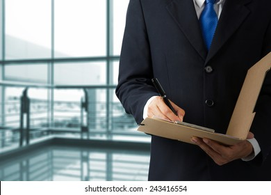 Businessman working with documents sign up contract at the office