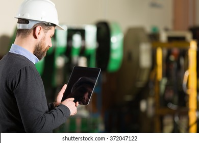 Businessman working in factory.