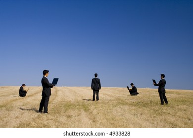 businessman working in a field making a teamwork with the nature