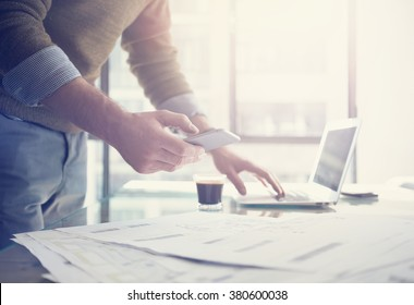 Businessman working generic design laptop and smartphone.  Working hard new architectural project. Blurred background, horizontal mockup.