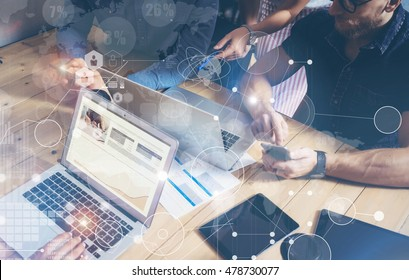 Businessman Working Global Strategy Virtual Icon.Innovation Graphs Interfaces.Men Wood Table Modern Laptop Loft Office.People Sharing Coworking Studio.Using Mobile,Notebook.Business Startup.Blurred