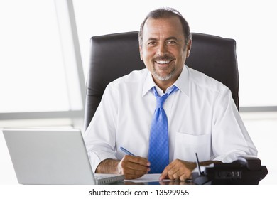 Businessman working hard at desk