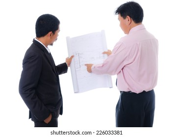 Businessman working hard, isolated on the white background.