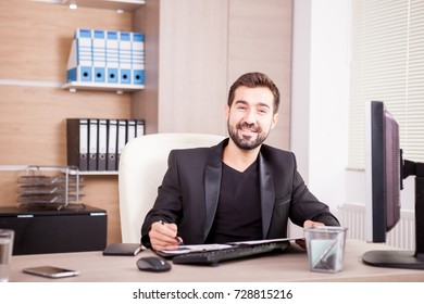 Businessman working at his office. Businessperson in professional environment