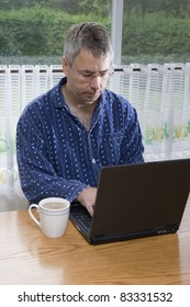 Businessman working from home in pajamas (SUMMER)