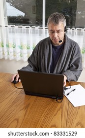 Businessman working from home in pajamas (WINTER)