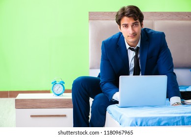 Businessman working in the hotel room